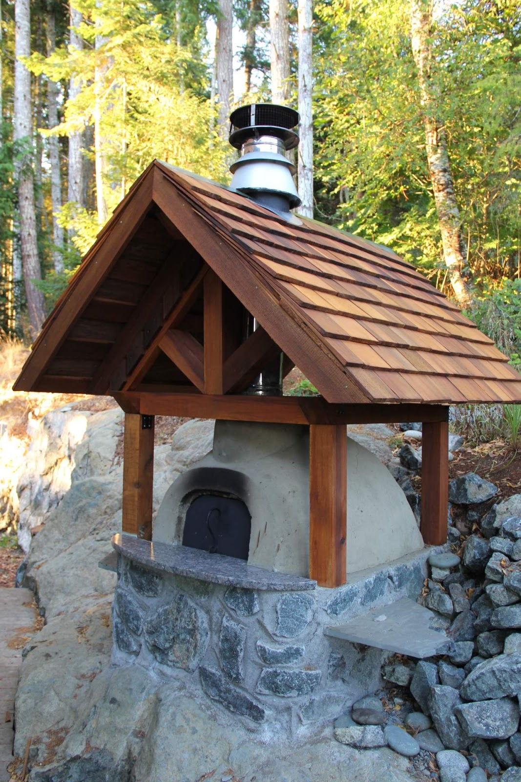 Living roof covers a cob oven my future hobbit house for How to make a cob oven