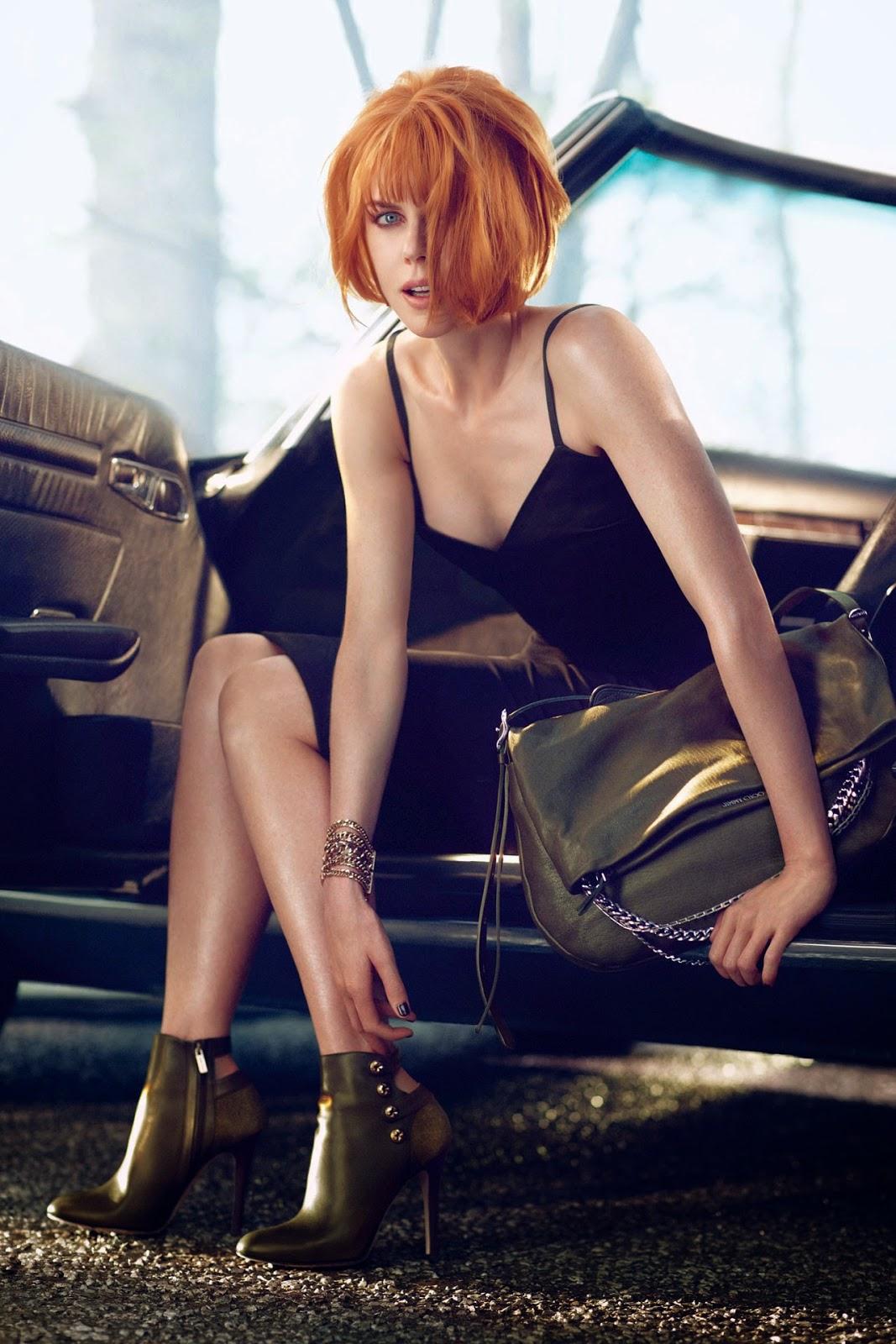 Nicole Kidman in a sexy photo shoot shoeing her legs