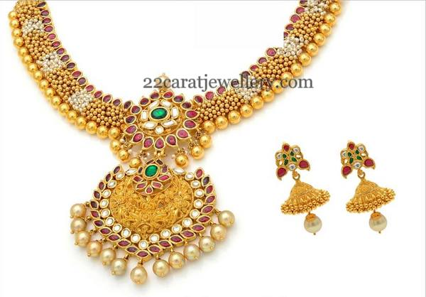 Gold Swirls Necklace by Neelkanth Jewellers