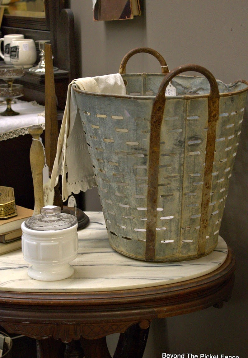 metal bucket, lace, antiques, how to decorate, Beyond The Picket Fence, http://bec4-beyondthepicketfence.blogspot.com/2015/02/5-decorating-lessons-from-store.html