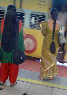 Freshly washed long hair girl at Mumbai railway station with fragrance of shampoo.
