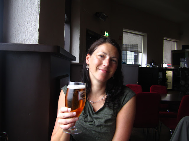 Woman with a beer in Reykjavik, Iceland.