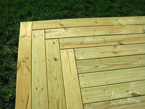 Log cabin design in a deck