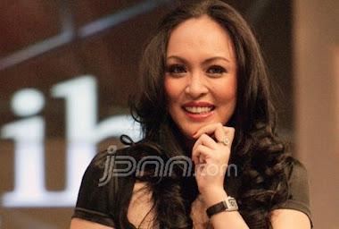 Dr. Hj. Angelina Patricia Sondakh Massaid, SE, MSi