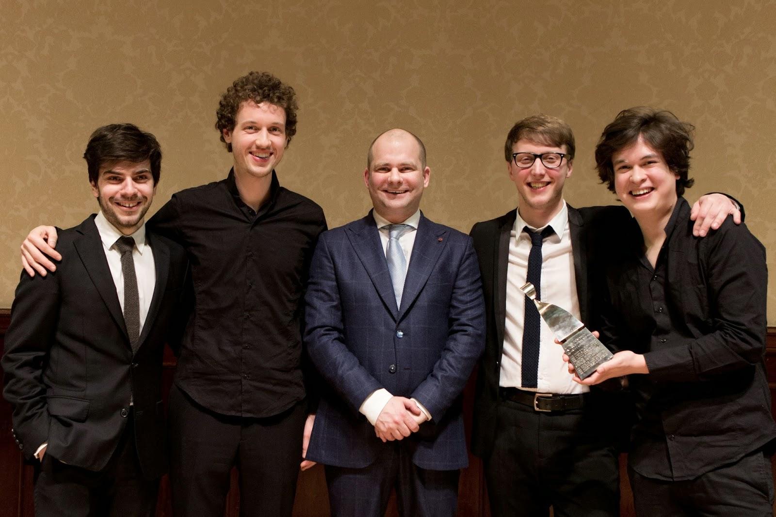 Van Kuijk Quartet receiving their award from competition chairman John Gilhooly - photo Ben Ealovega