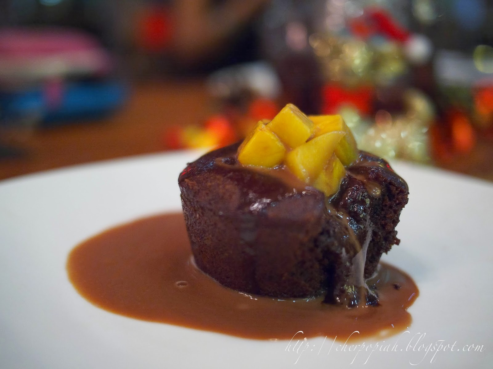 chocolate lava cake brownie with mango and caramel
