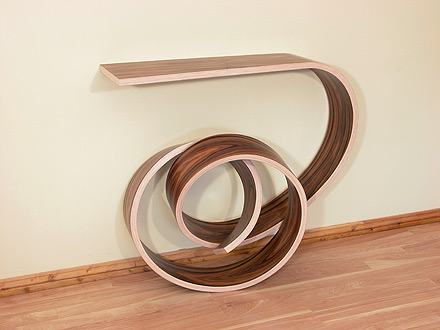 The Nebula Console Table is a wooden roller coaster spinning through your  room. The contrast between the rich dark rosewood veneer of the outside and  the ...