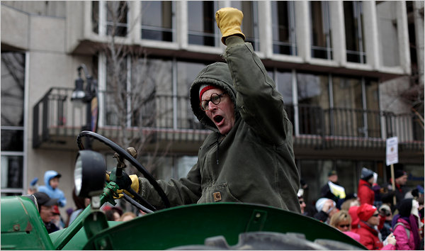 A protestor drives a tractor at a protest in Wisconsin