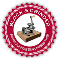 Red circular postage stamp logo with the words Block & Grinder at the top of the circle and image of an old-fashioned meat grinder in a white circular center. The words butcher's shop - prime steaks-burgers & more are in the bottom half of the red circle.