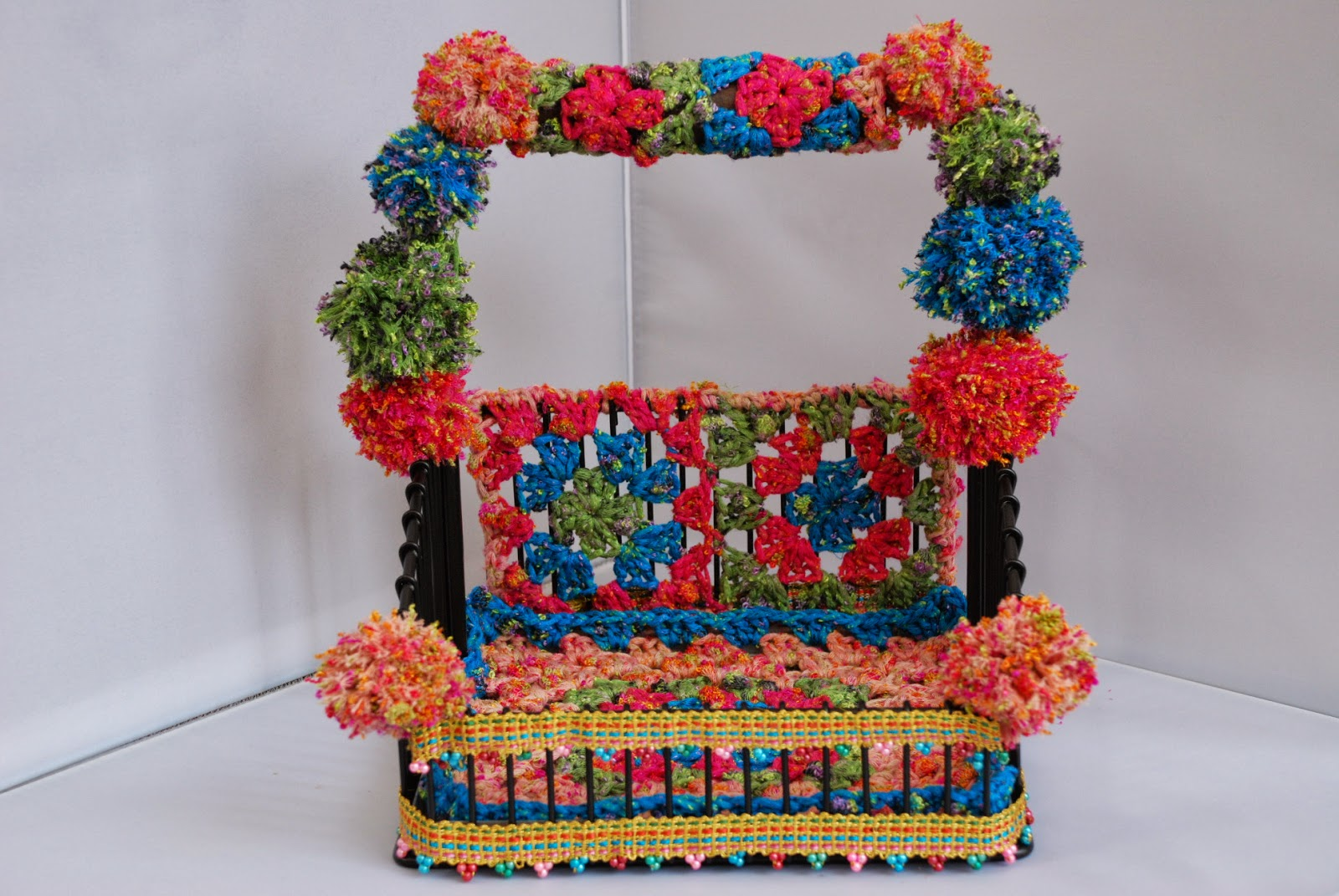 image of yarn bombed basket