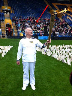 fratton park football ground with olympic torch flame
