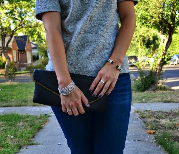 skinny jeans, black clutch, grey shirt