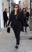 Kim Kardashian wearing a black outfit