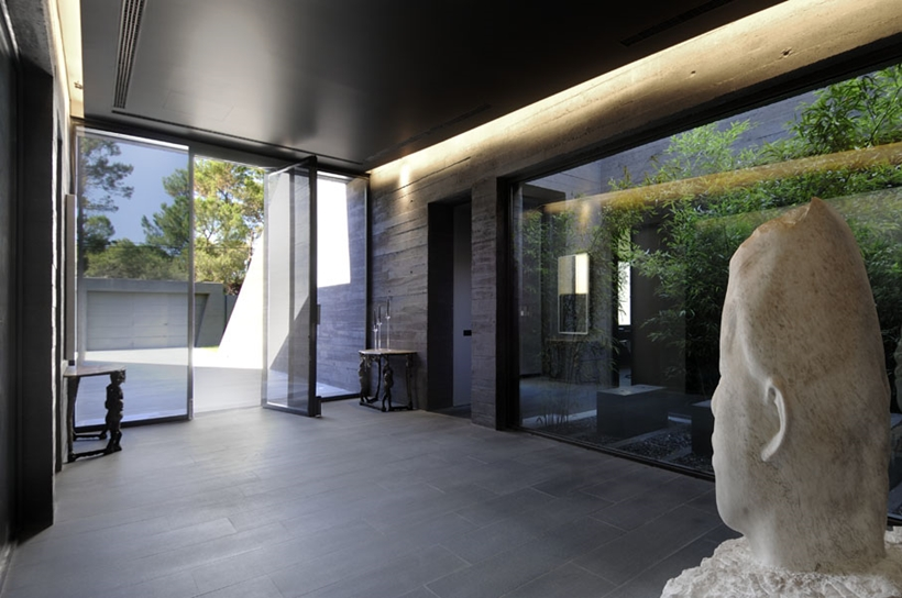Glass walls of Ultra Modern Concrete House by A-cero Architects