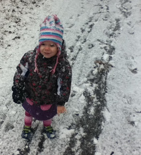 Baby-G hiking while the snow is falling.