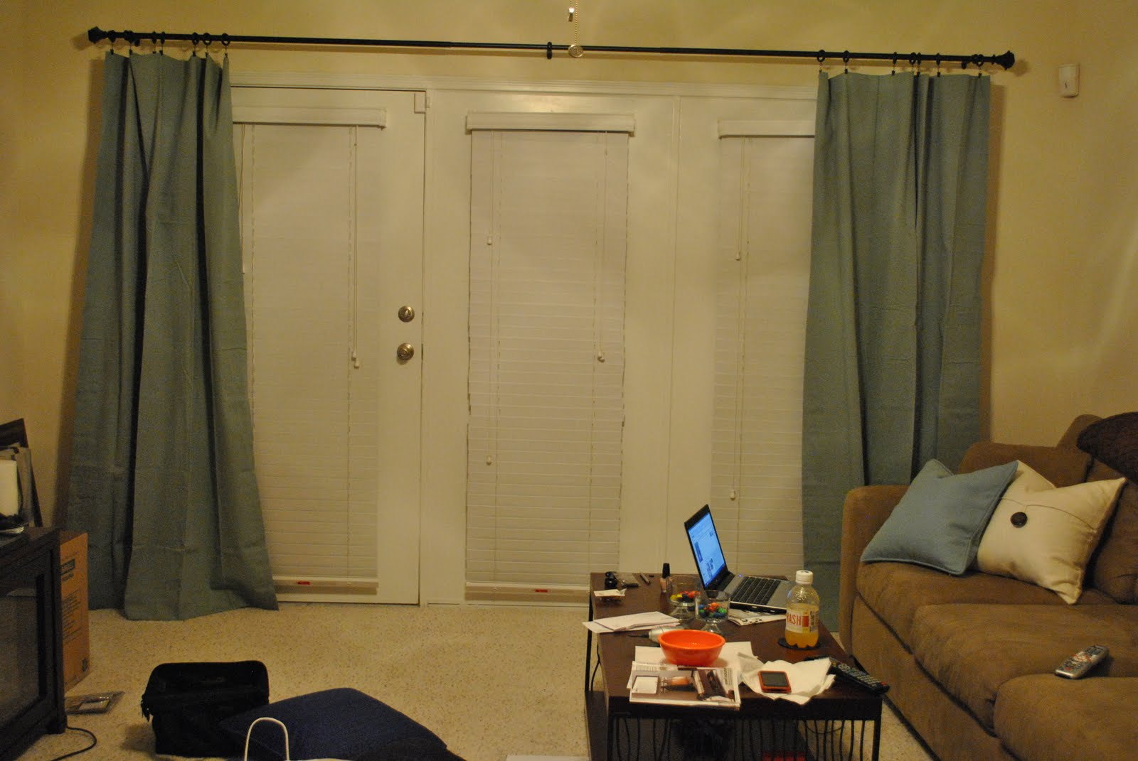 curtains add a nice splash of color to our neutral living room title=