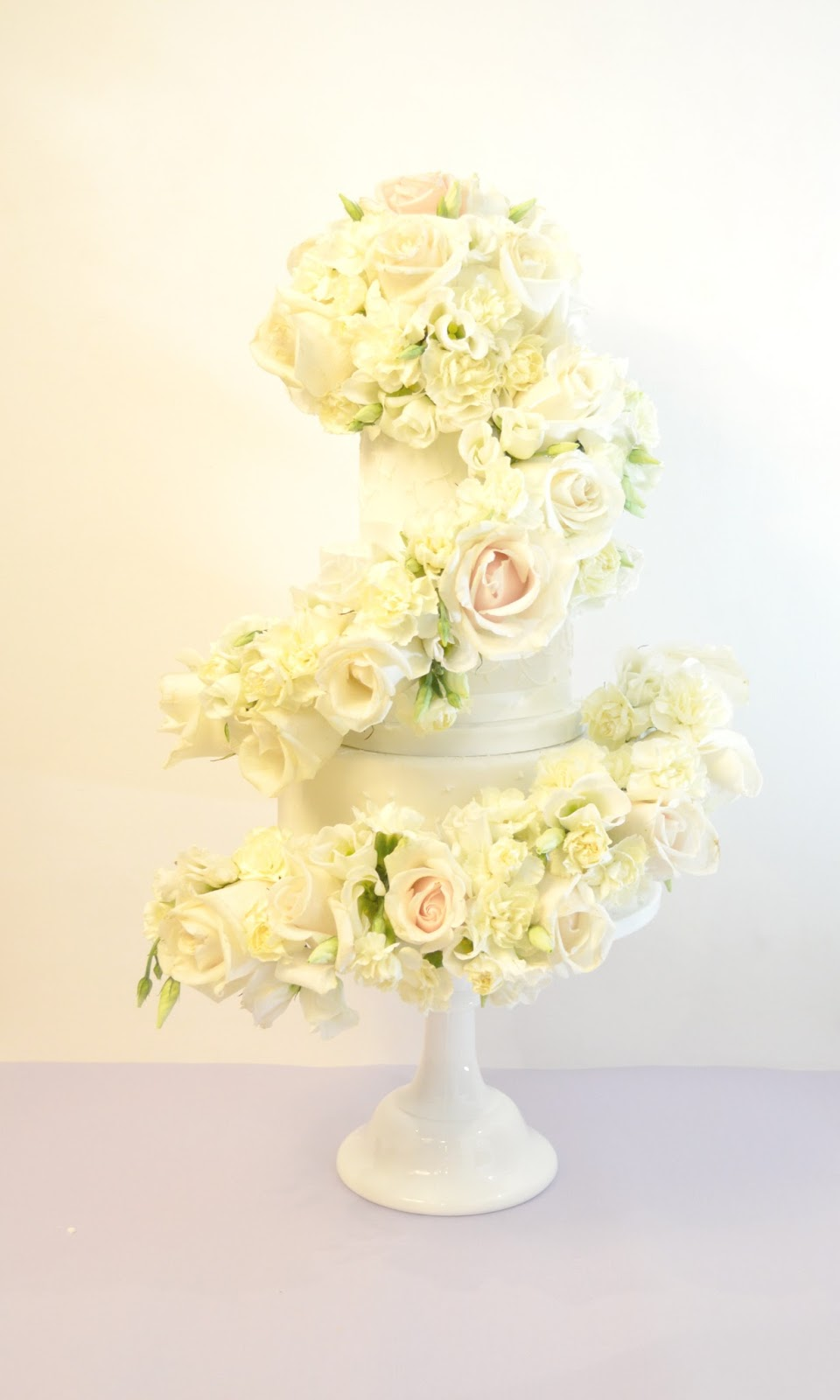 Cherie Kelly's Ivory Rose Cascade Wedding Cake