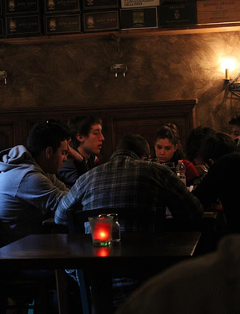 youngsters hanging out at a restaurant in Europe