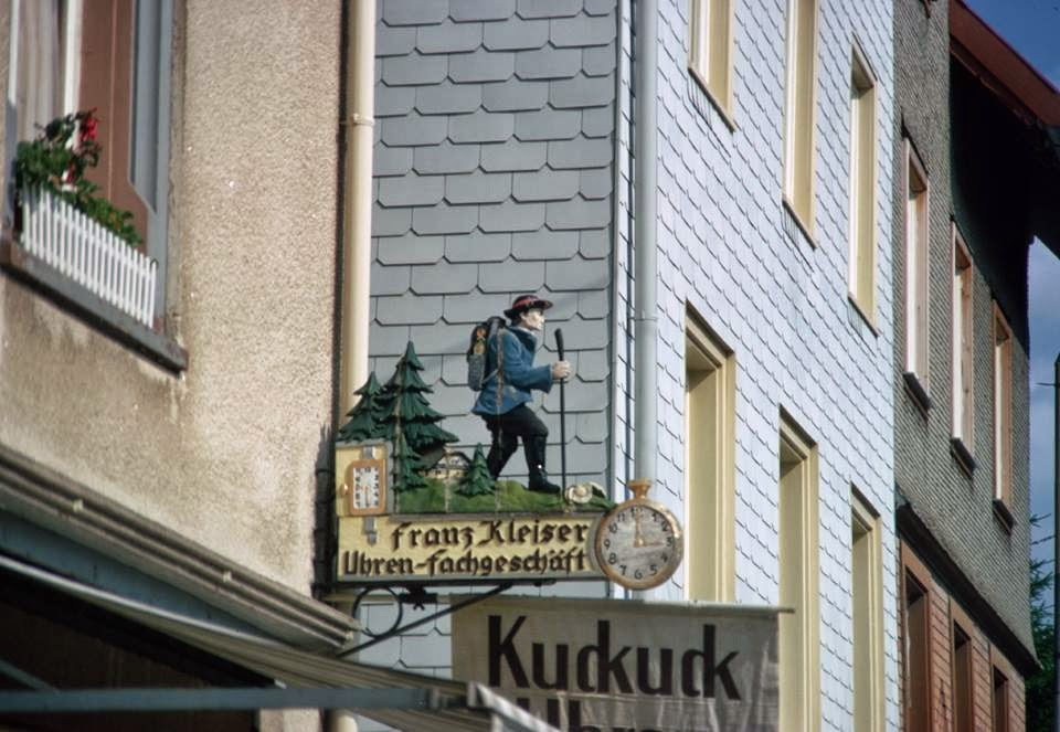 "Clockmaker sign (""happy wanderer""), Furtwangen, Black Forest, Germany (1970)  Signs: ""Franz Kleiser"