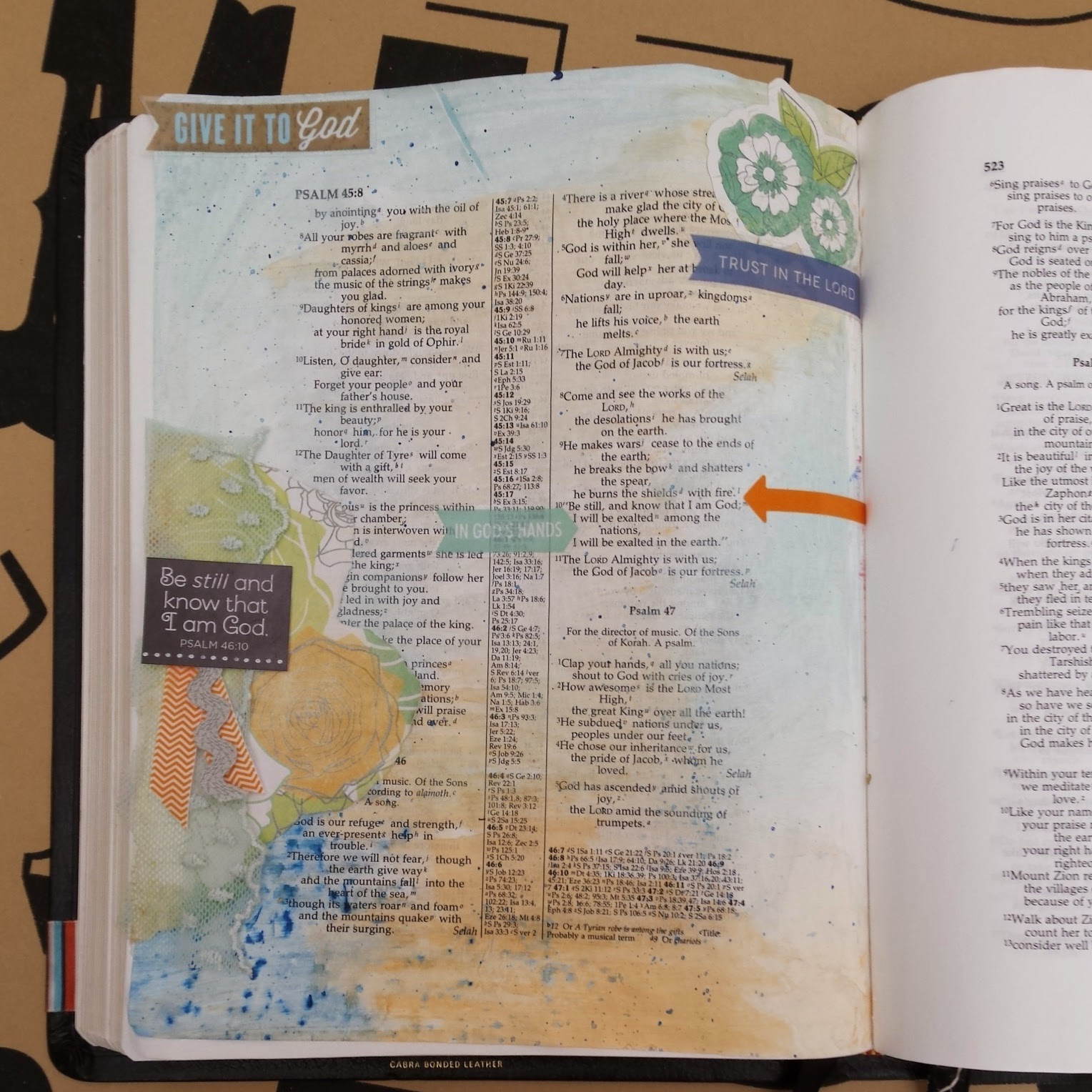 Journaling Bible art for Psalm 46:10 in stickers and paint of orange and blue.