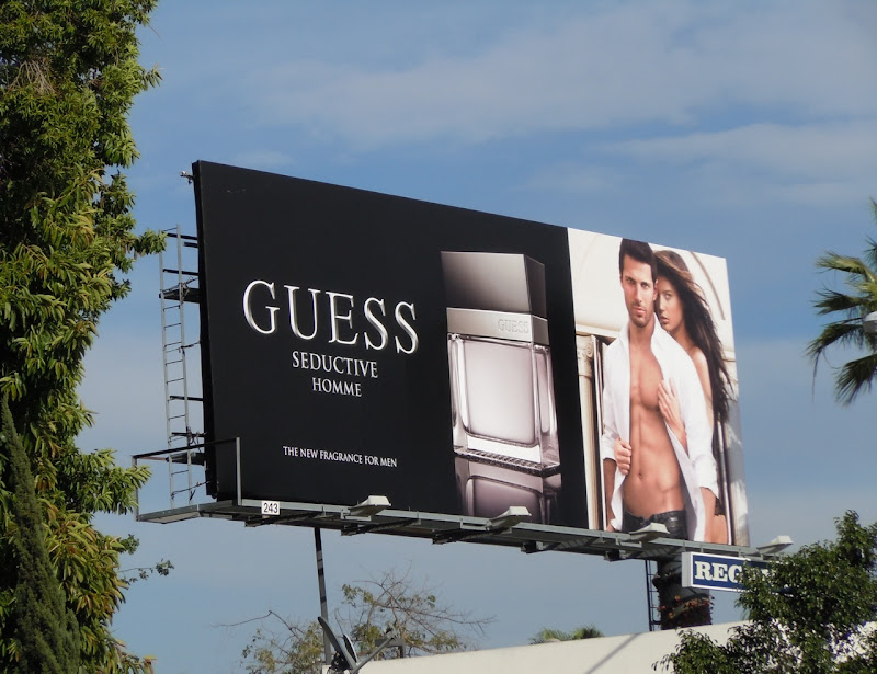 Guess Seductive Homme fragrance billboard