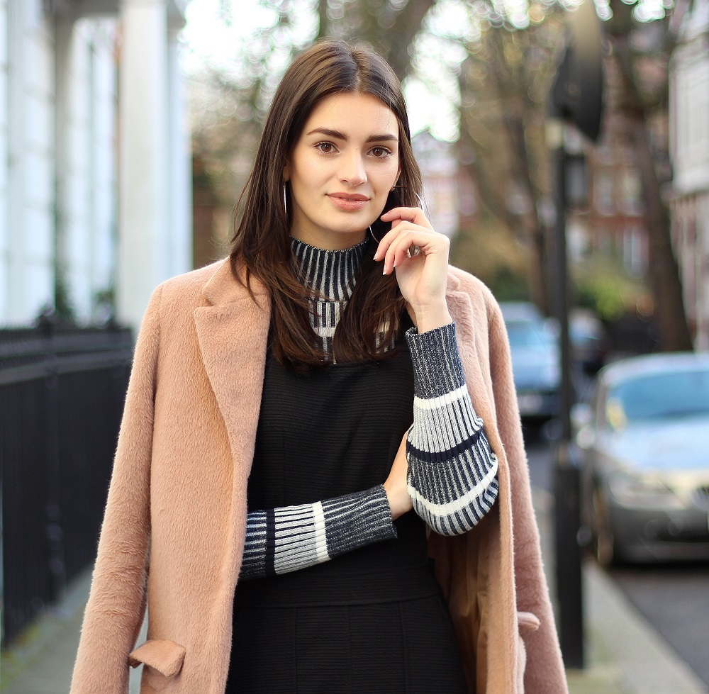 salmon pink coat and striped roll neck jumper