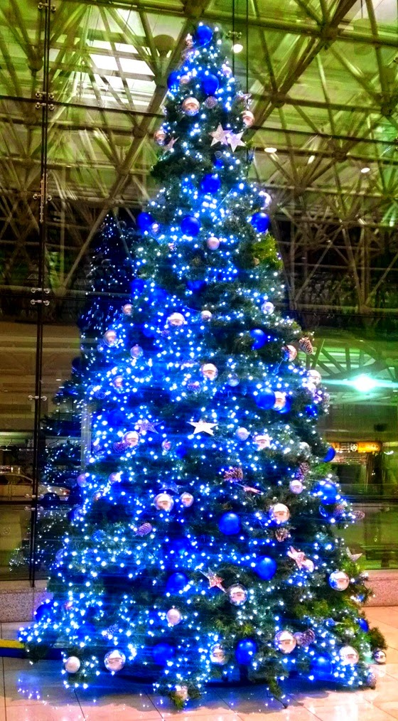 Christmas tree decorated all in blue
