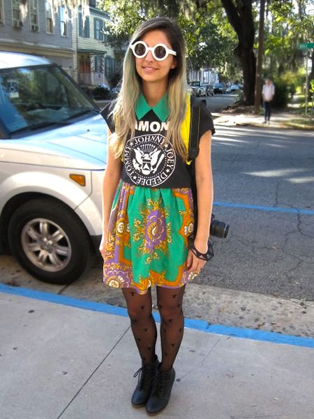 Jackie Gasc, SCAD student and Fashion blogger wearing an oriental print dress, black stockings and big white round