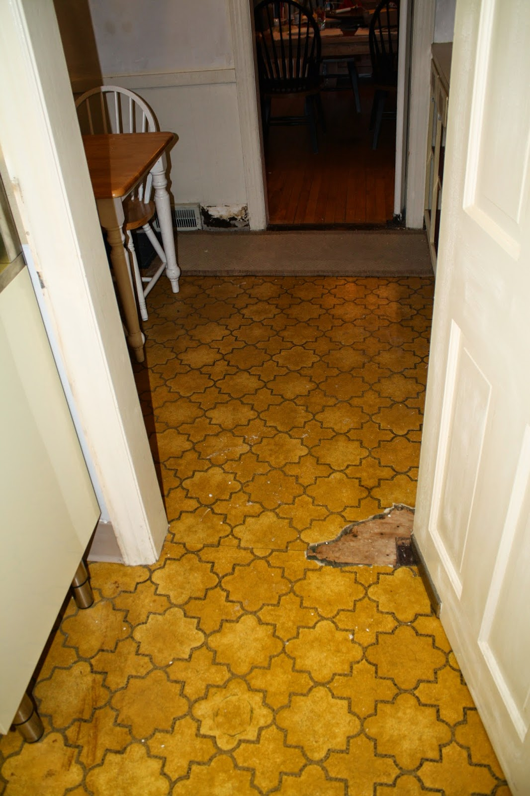removing linoleum floors - restoring wood floors