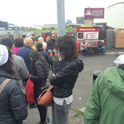 Waiting in line at the famous Baejarins Beztu Pylsur in Reykjavik.