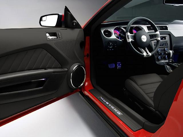 Interior shot of 2011 Ford Mustang GT through open door