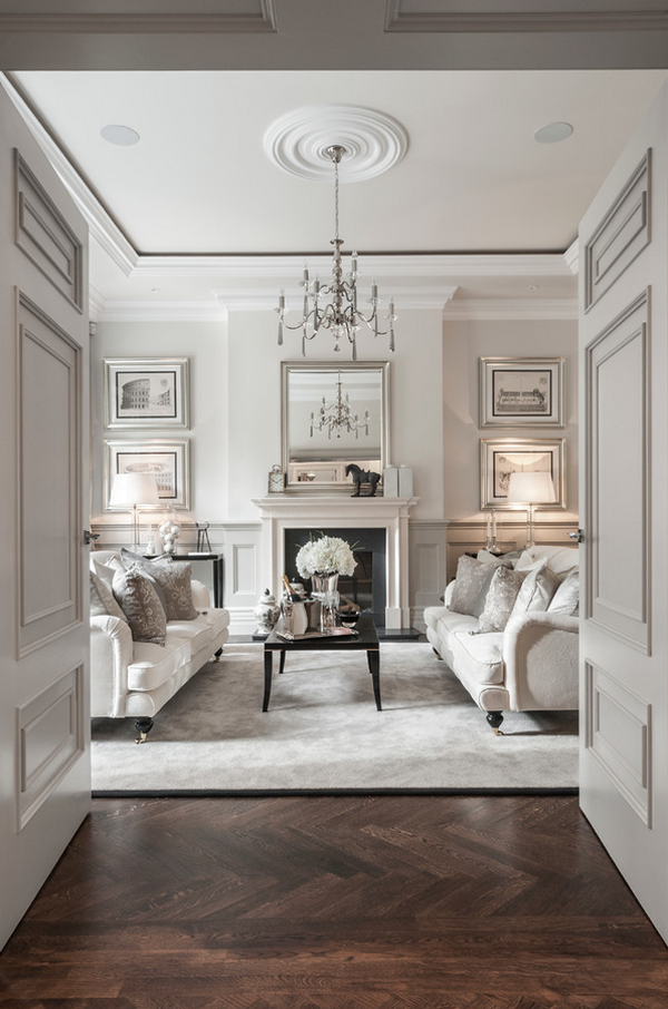 Salón decorado con paredes en gris humo y muebles blancos Los