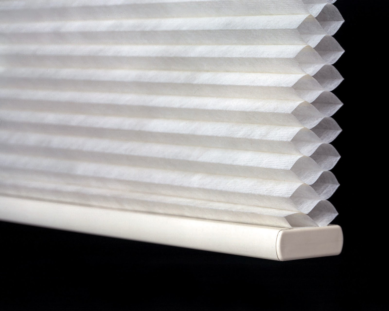 Cellular shades act as an insulating barrier between the window and the room, effectively reducing heat transfer.