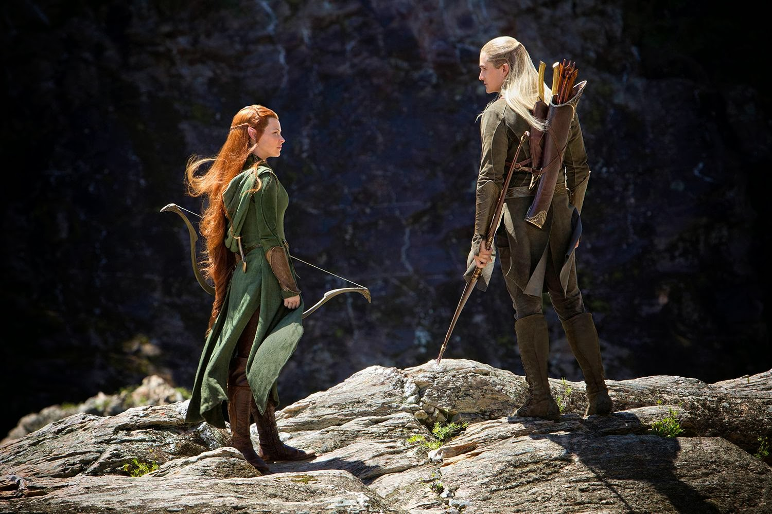 Orlando Bloom as Legolas and Evangeline Lilly as Tauriel in The Hobbit: The Desolation of Smaug