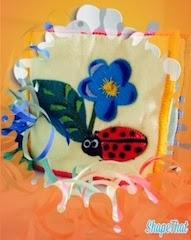 Coccinella e fiore di Stoffa su cornice fantasia arancione