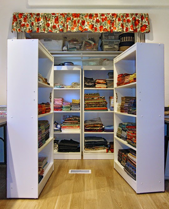frabric storage system: Front storage units rolled out of closet