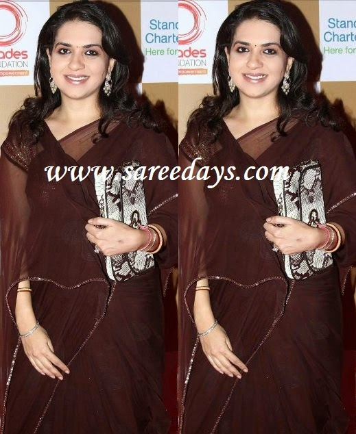Latest saree designs shaina nc in dark brown designer saree checkout shaina nc in dark brown designer saree with small work border and paired with matching short sleeves blouse with work altavistaventures Images