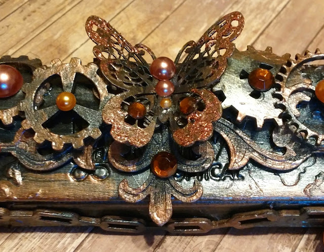 Mixed Media Glasses Case tutorial by Gabrielle Pollacco using Bo Bunny Ironworks wood accents, Pearlescents, Glitter Paste, Lasercut chipboard and Stickable stencils.