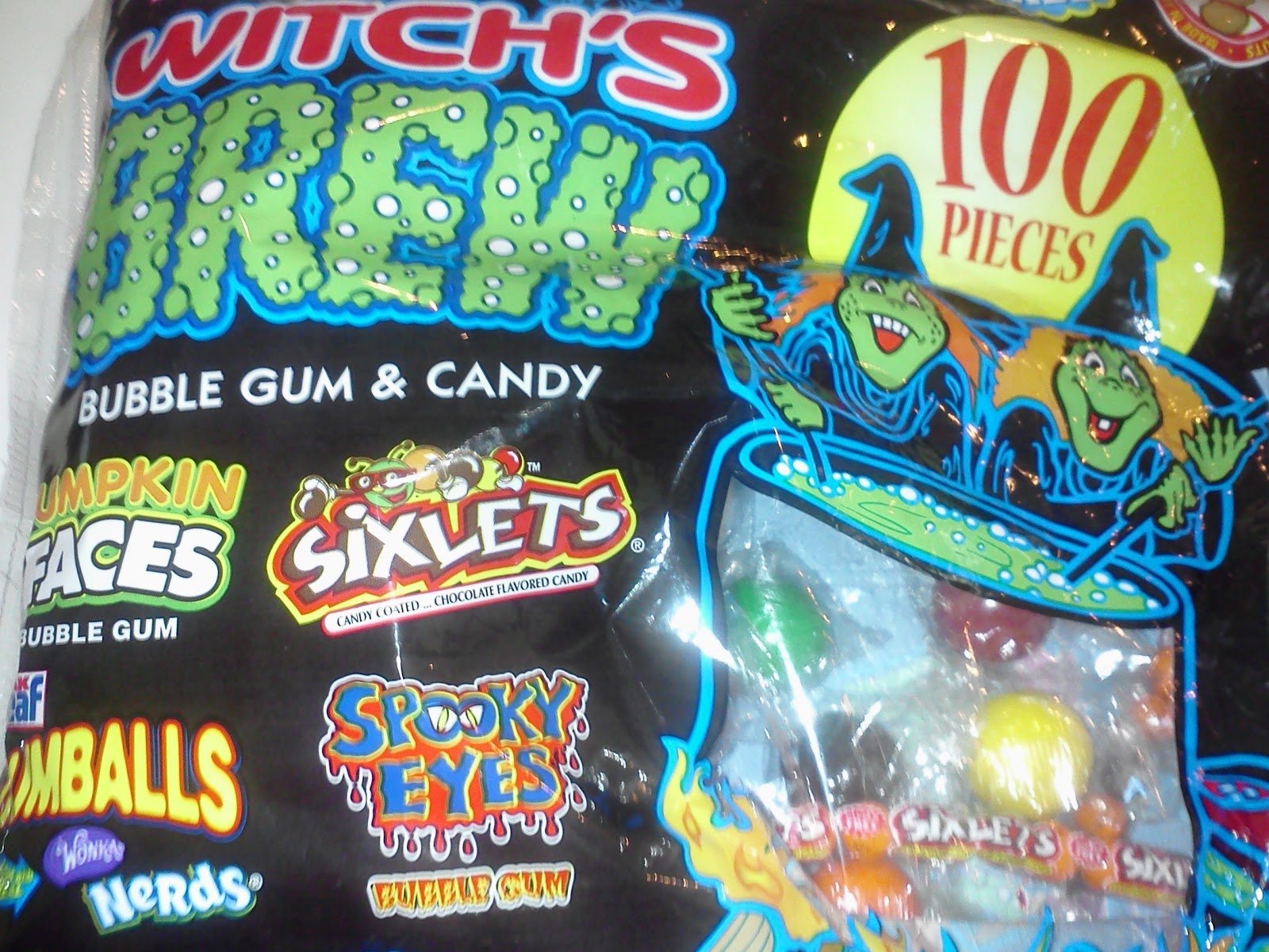 front of the bag its called witchs brew and has gumballs jack o lantern and eyeballs and black and orange sixlet candies among other nut free treats