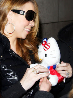 Mariah Carey cuddling a cute Hello Kitty plush soft toy