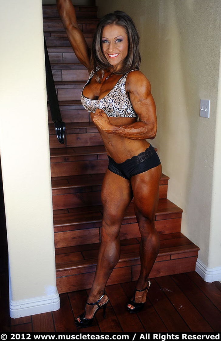 Marga Overby Flexes A Bicep And Models Her Muscular Calves In Heels