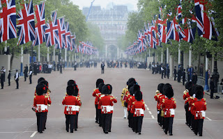 a military band perform as they march on the Mall, in central London, on the day of the Royal Wedding