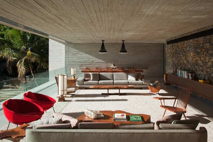Living room in Modern beach house in Brazil by Marcio Kogan