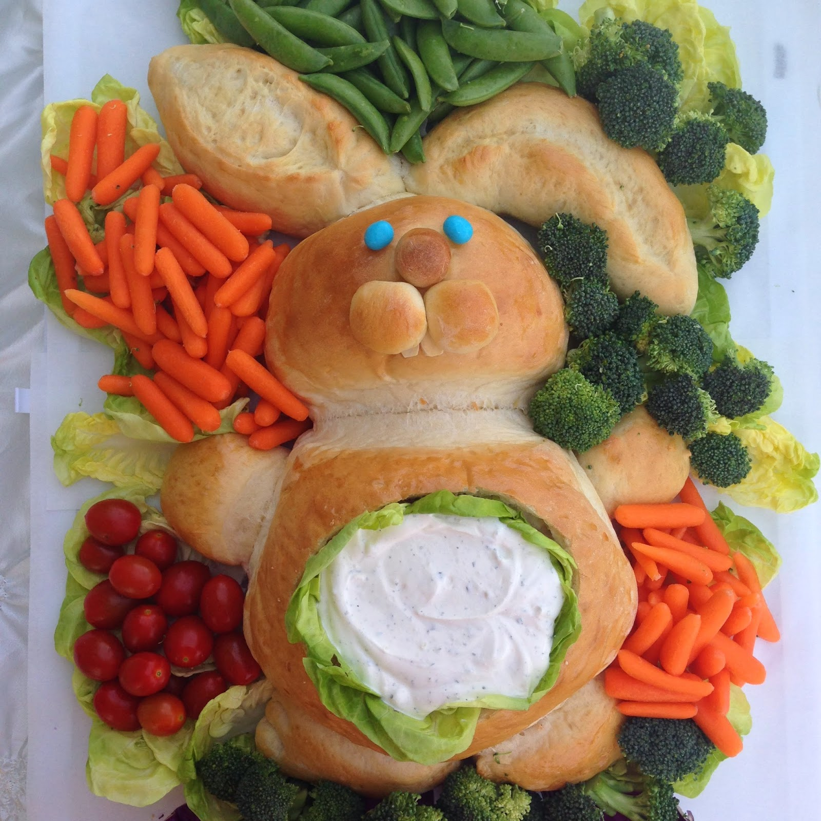 trying out new fun recipes for easter dinner - easter bunny bread with dip, easter bunny rolls and white chocolate mousse egg cups