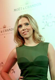 Scarlett Johansson wearing a black dress with see thru top