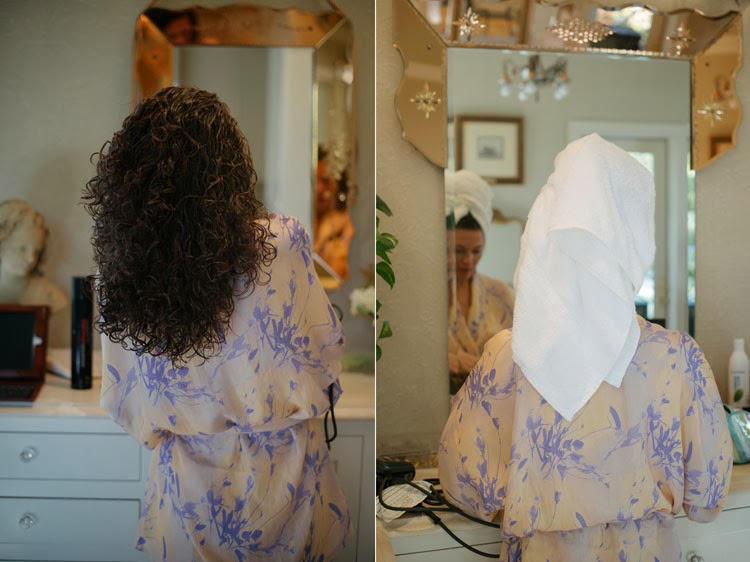 bride dressing in front of beautiful vanity in a lovely purple robe