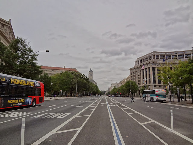 Riding a city bike in the middle of the street in Washington.