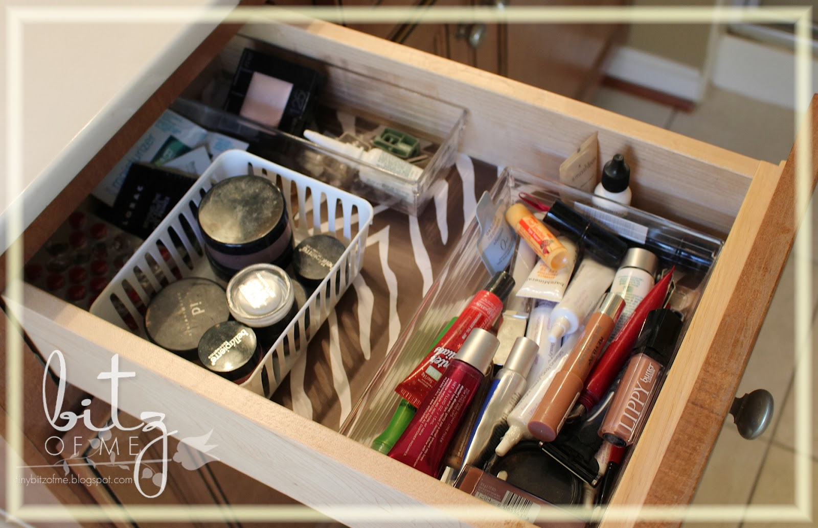 I also lined both of my vanity drawers with my zebra contact paper. This  drawer holds extra makeup, makeup samples I'm trying out and my collection  of lip ...