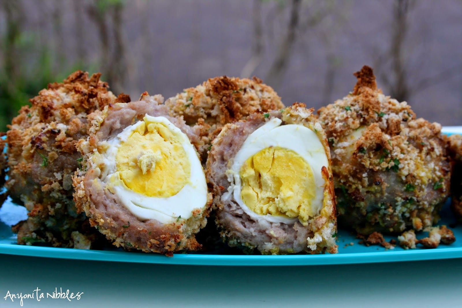 A Scotch egg is a boiled egg wrapped in sausage and breadcrumbs from Anyonita Nibbles