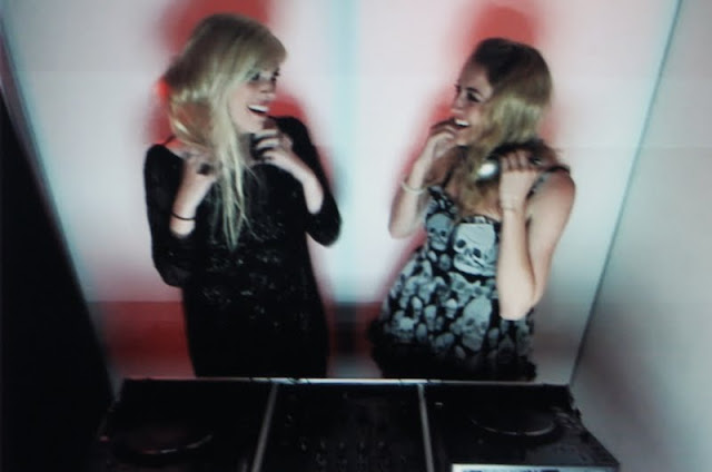 Emily and Abigail of WanderLust in the DJ photo booth at the Gen Art Film Festival after party at Hiro